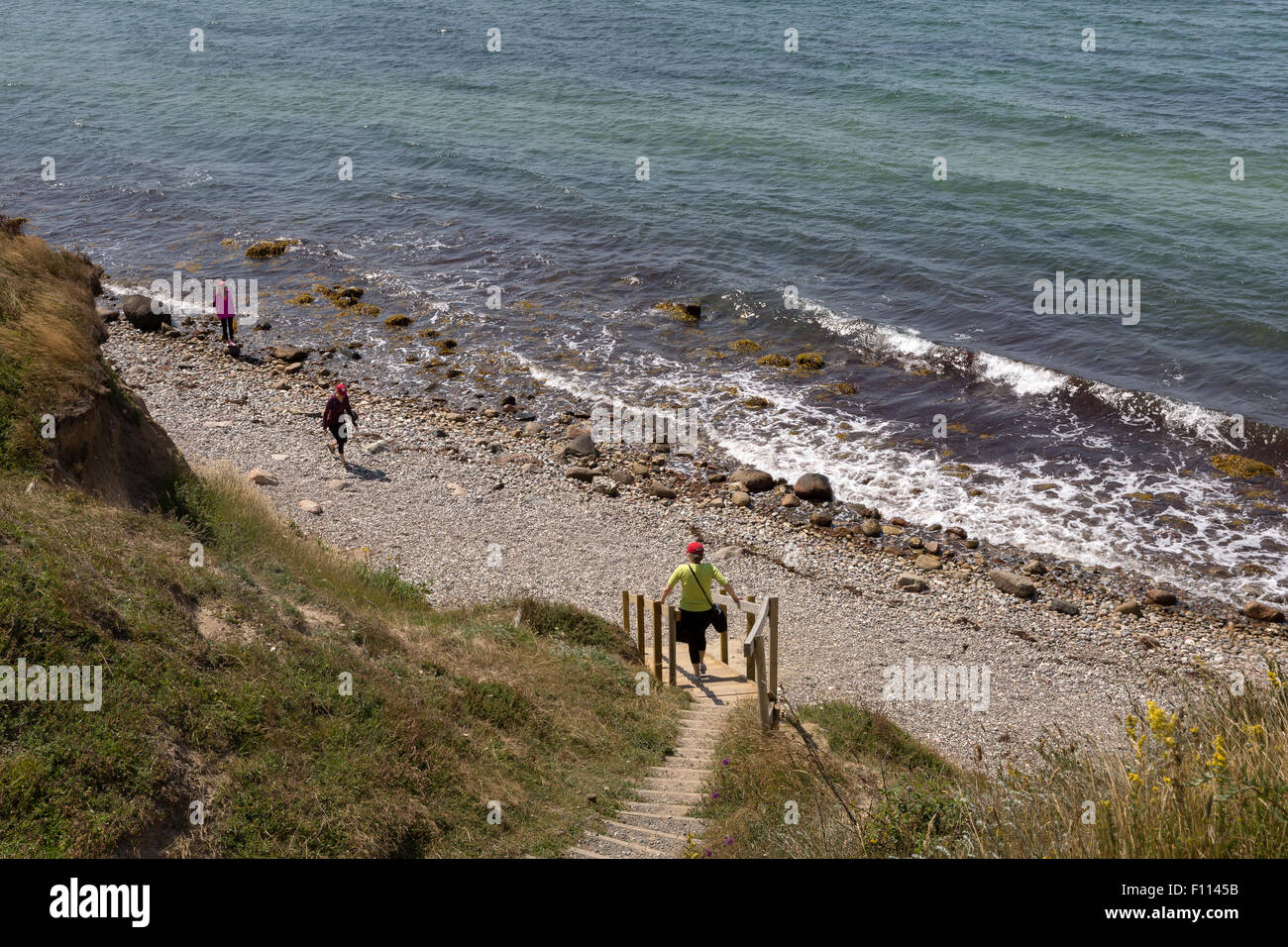 Tourists at the beach at Voderup Klint on the island of Aero, Denmark - Stock Image