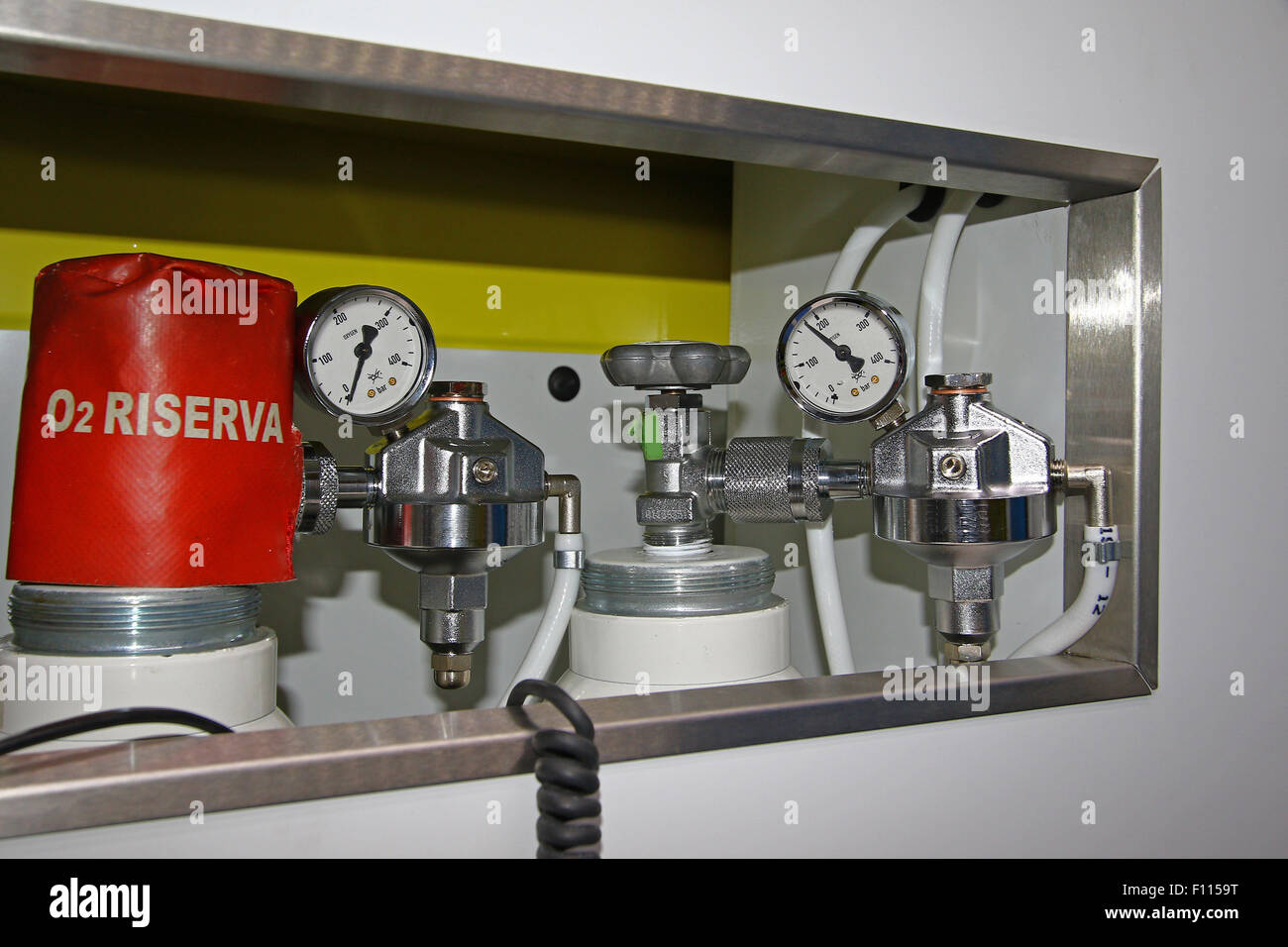 Top gages on medical oxygen tanks in a modern ambulance - Stock Image