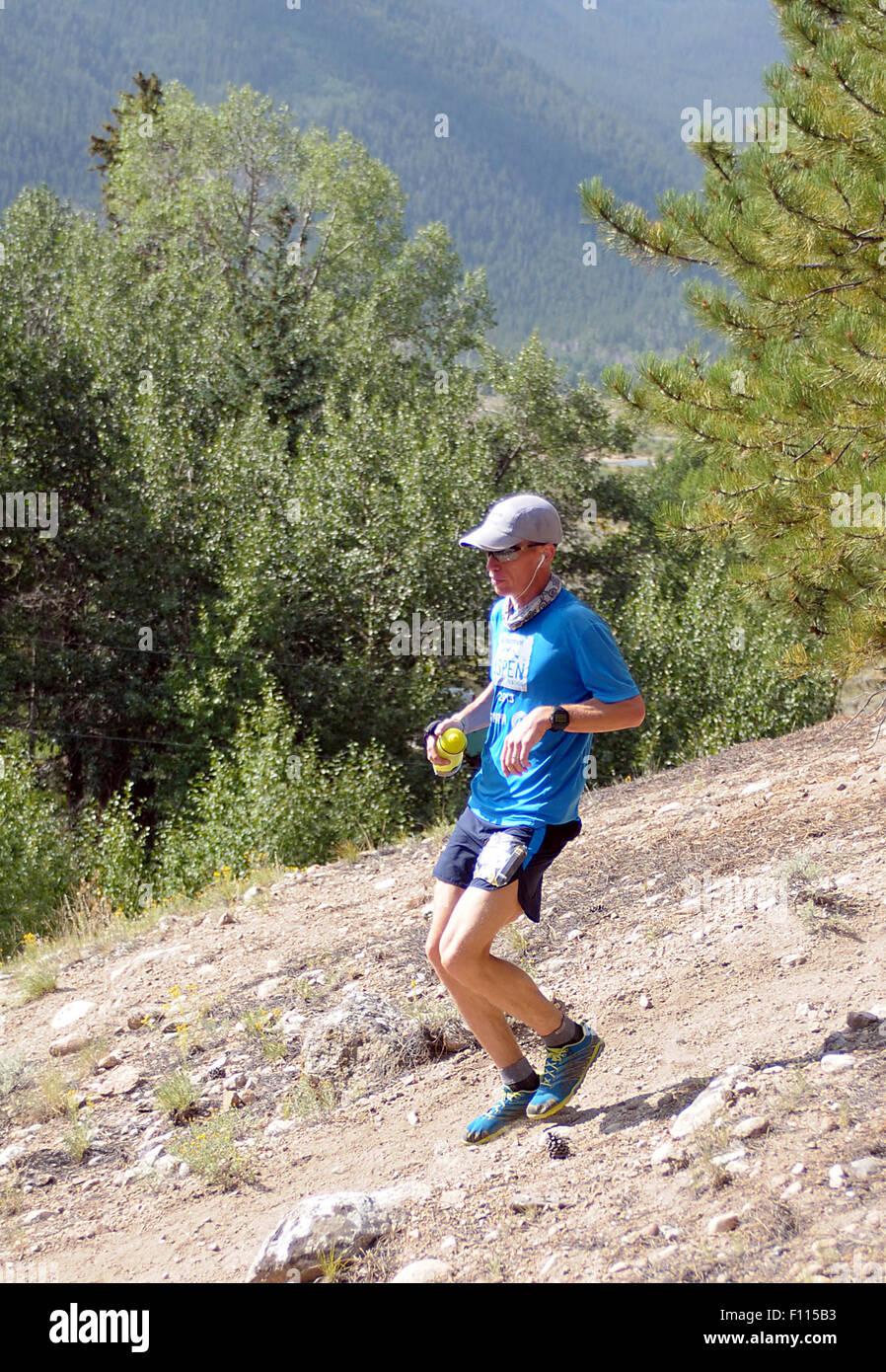 Leadville, Colorado, USA. 22nd Aug, 2015. Colorado runner, Jeason Murphy, negotiates a tricky downhill section near - Stock Image