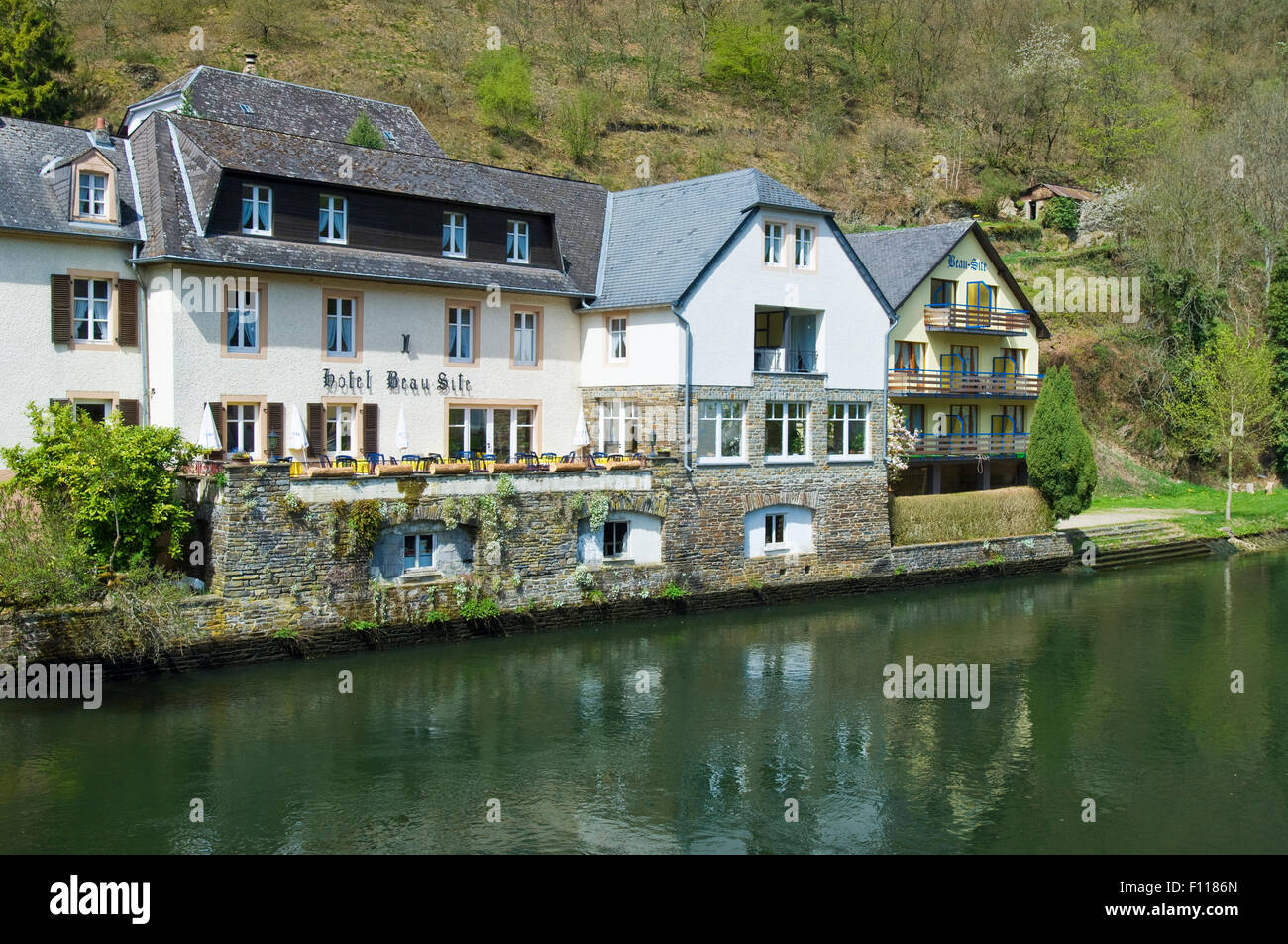 Hotel Beau Site on the banks of the River Sure  in the village of Esch-sur-Sure in The Ardennes in Luxembourg - Stock Image