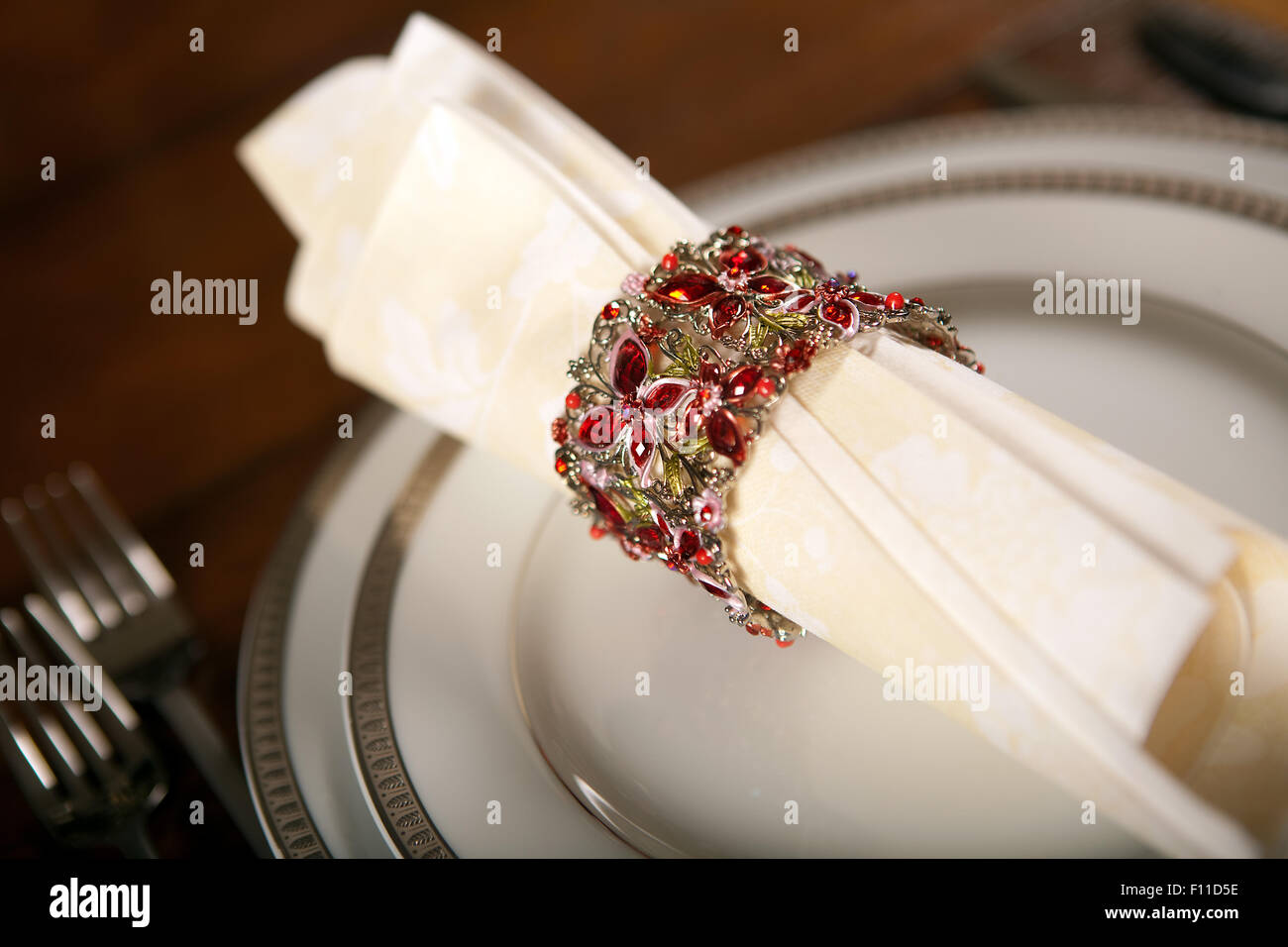 Cream Colored Festive Napkin With Ornate Fancy Napkin Ring On A Stock Photo Alamy