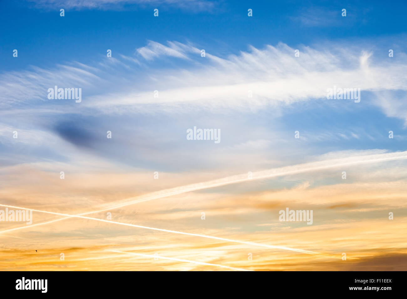 Geo engineering through airplane chemtrails sprayed in the sky, making it cloudy and polluting the environment. Stock Photo