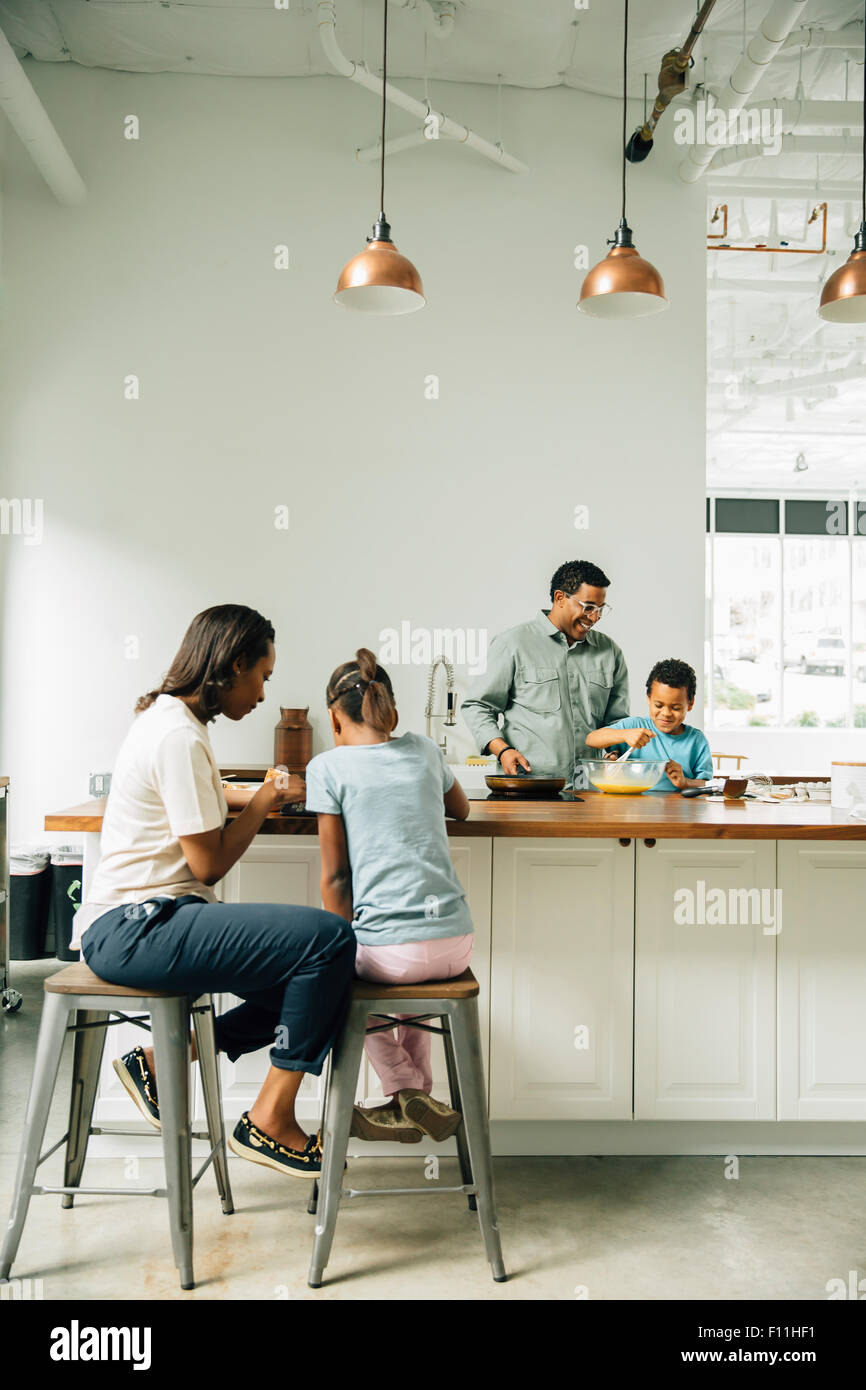 Family cooking in kitchen Stock Photo