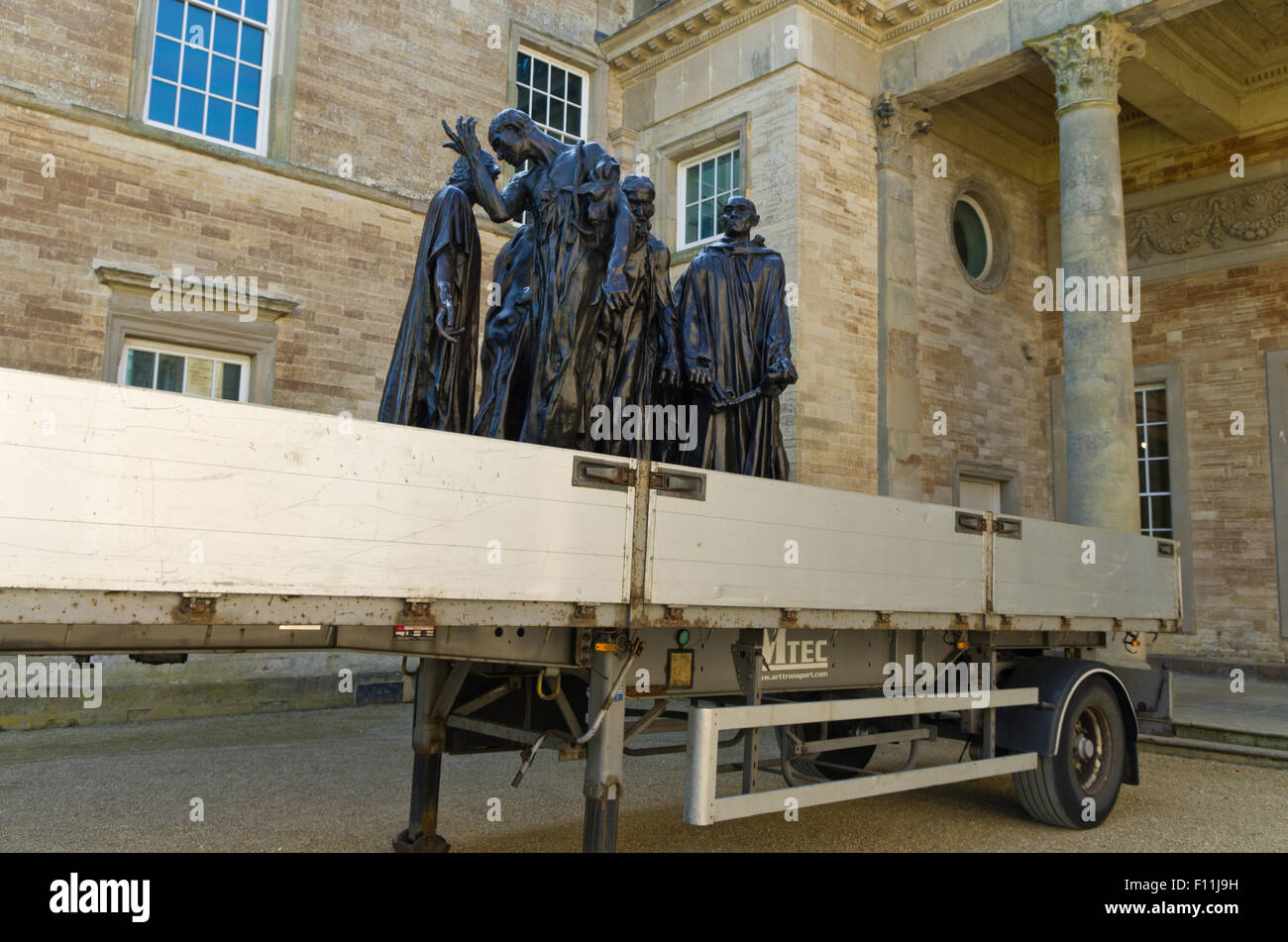 One of Auguste Rodin's most famous sculptures, The Burghers Of Calais, on the back of a removal truck, Compton - Stock Image
