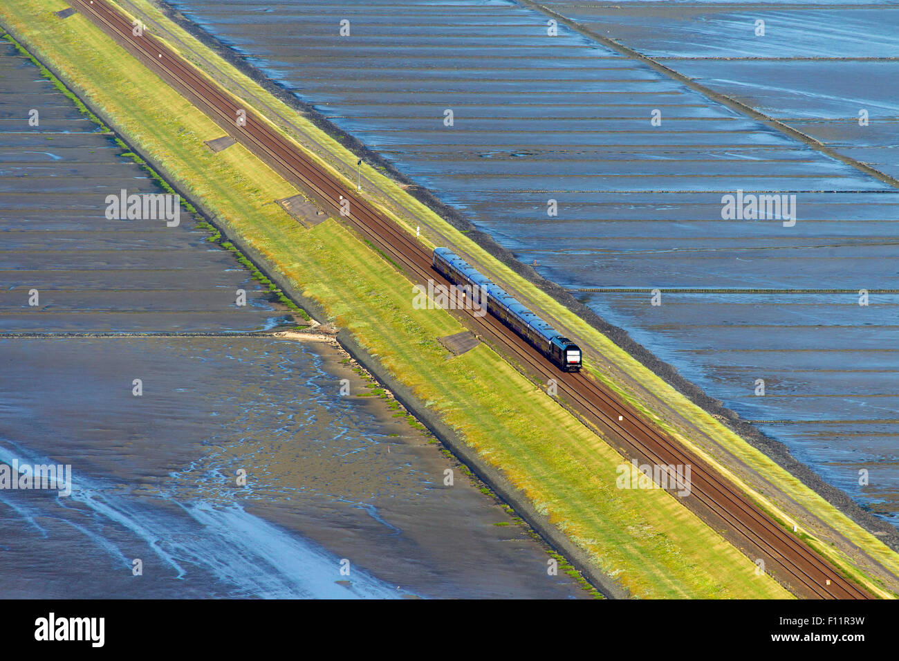 Train the Hindenburg Dam, causeway joining the North Frisian island Sylt to the mainland Schleswig-Holstein, - Stock Image