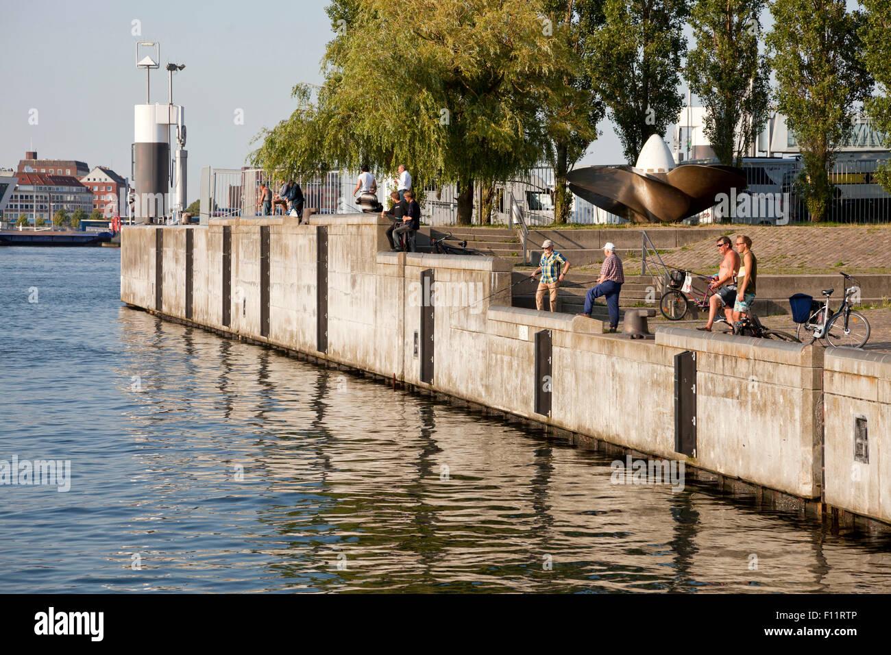 Anglers at the Kiel Fjord shore, Kiel, Schleswig-Holste - Stock Image