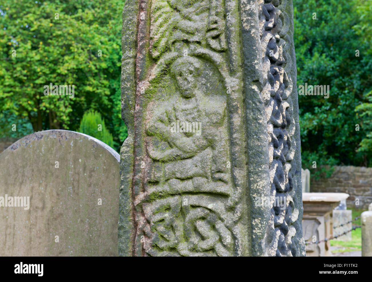 Celtic cross in the churchyard of St Lawrence's Church, in the village of Eyam, Peak National Park, Derbyshire, - Stock Image