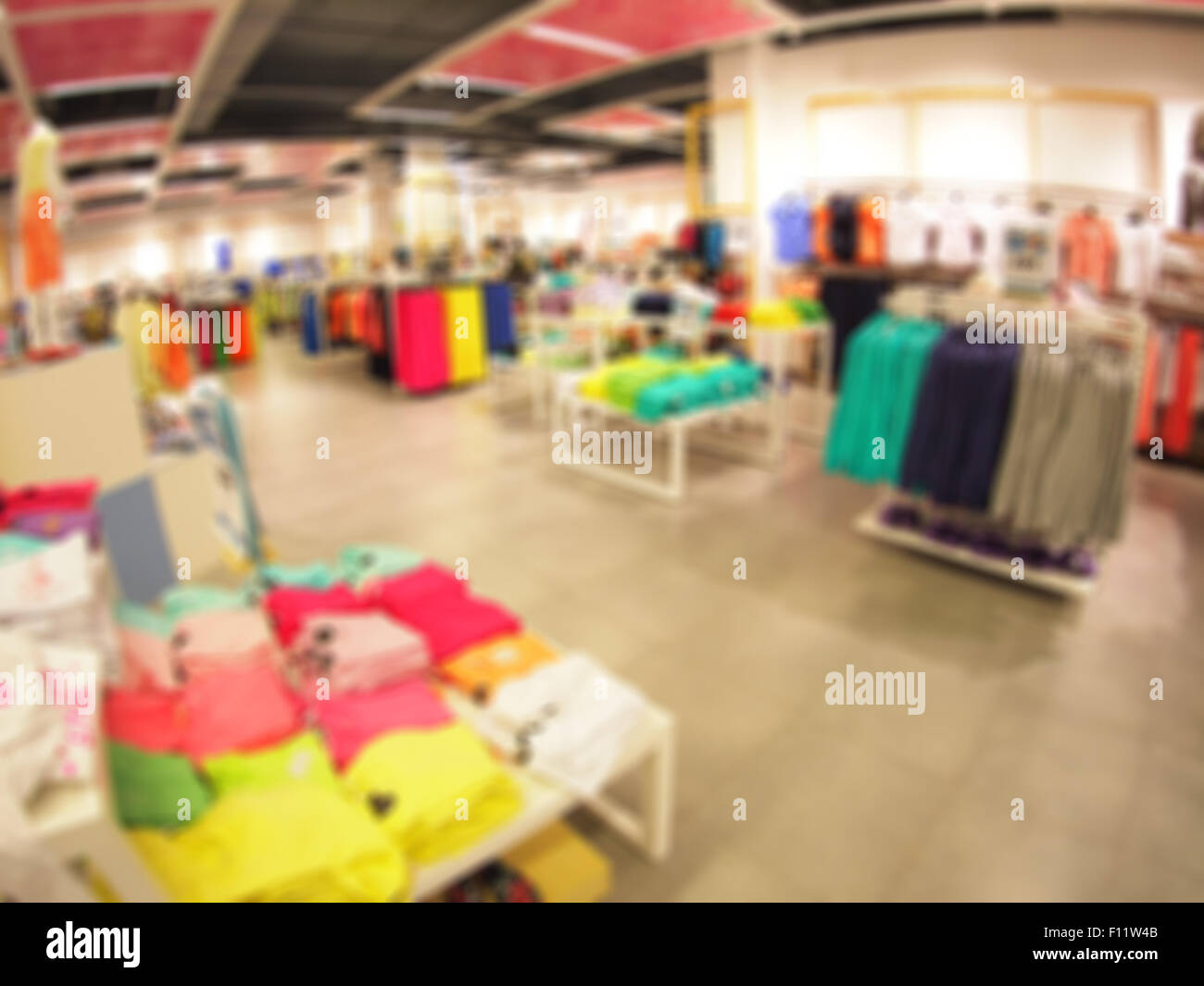 Defocused And Blurry Image Of The Interior Of A Clothing Store With Wide  Angle Distortion View Was Blurred For Use As A Backgrou