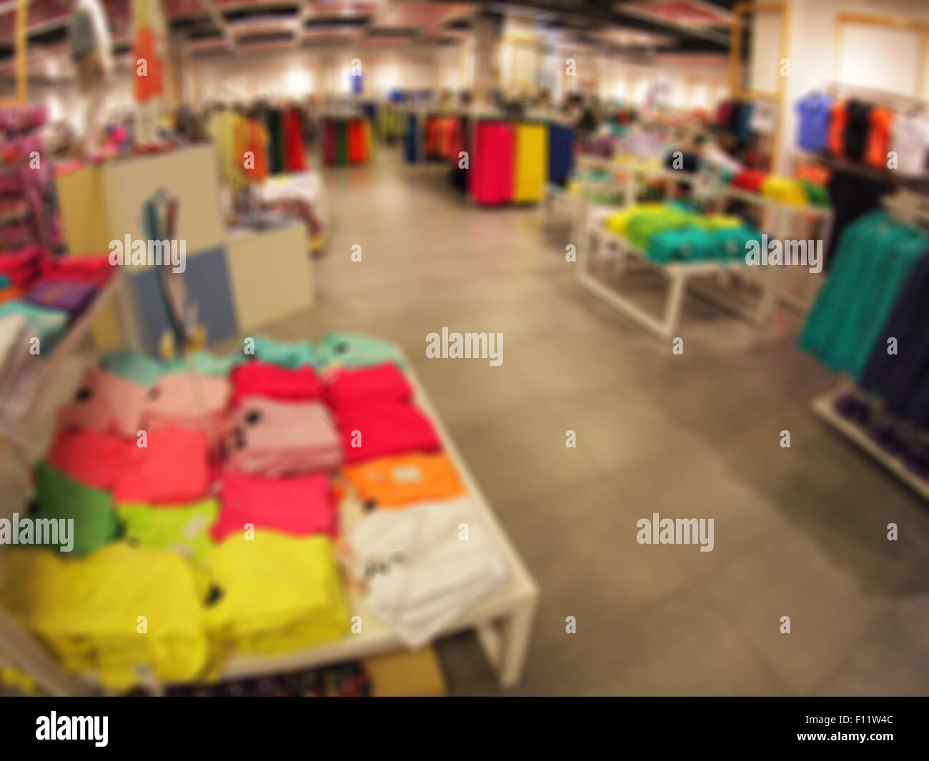 Defocused And Blurry Image Of The Interior Of A Clothing Store With Wide  Angle Distortion View Was Blurred For Use As Background