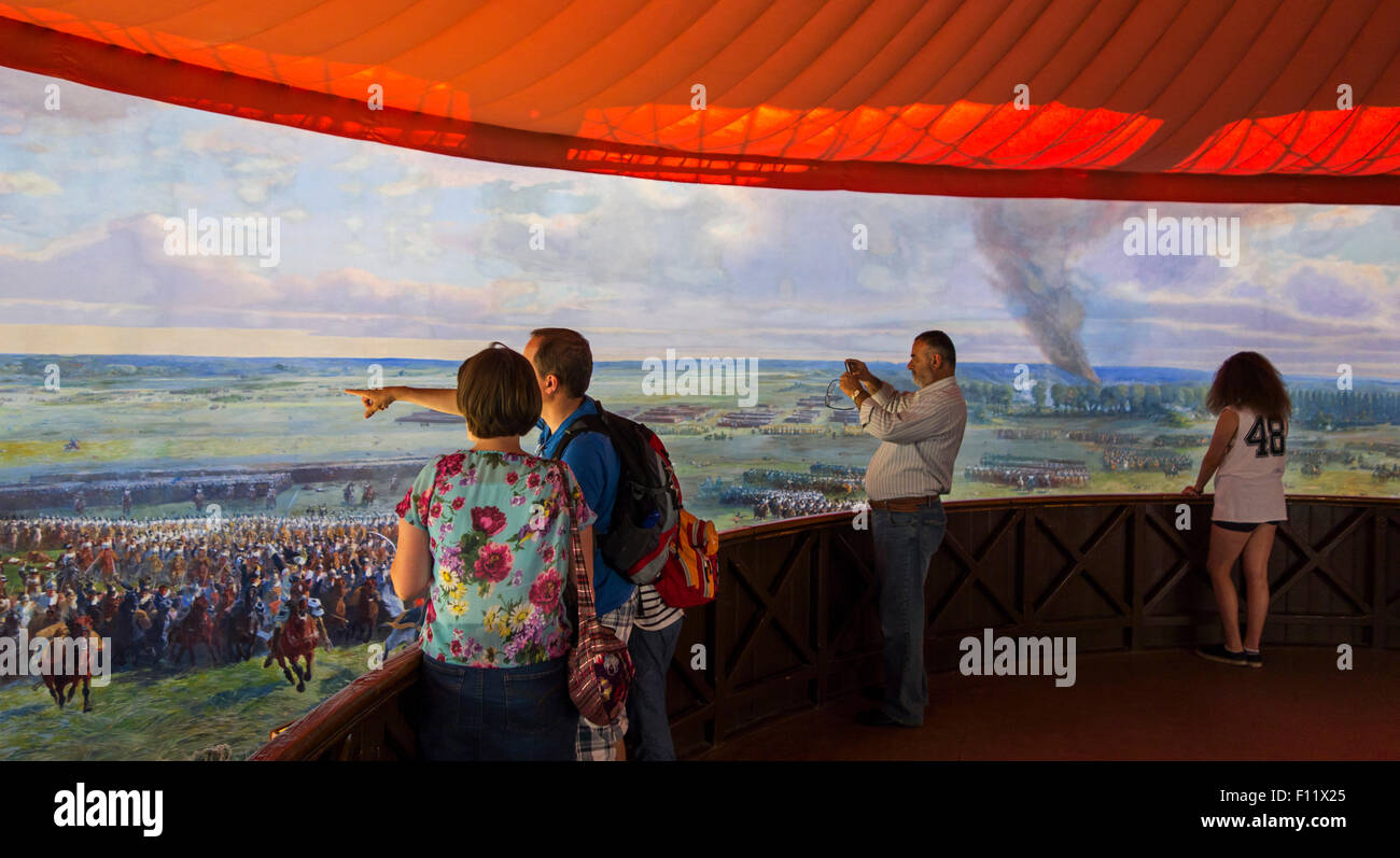 Tourists watching battle of Waterloo battlefield scenes in 360° fresco by Louis Dumoulin at Panorama, Braine - Stock Image