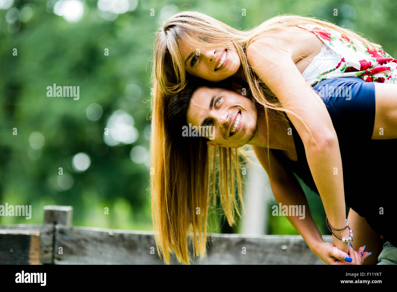 Happy couple in love having fun outdoors and smiling Stock Photo