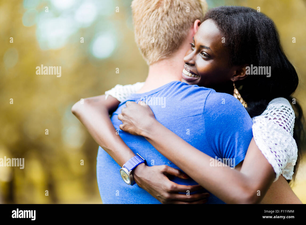 Couple in love hugging peacfully outdoors and being truly happy. Feeling of security and serenity - Stock Image