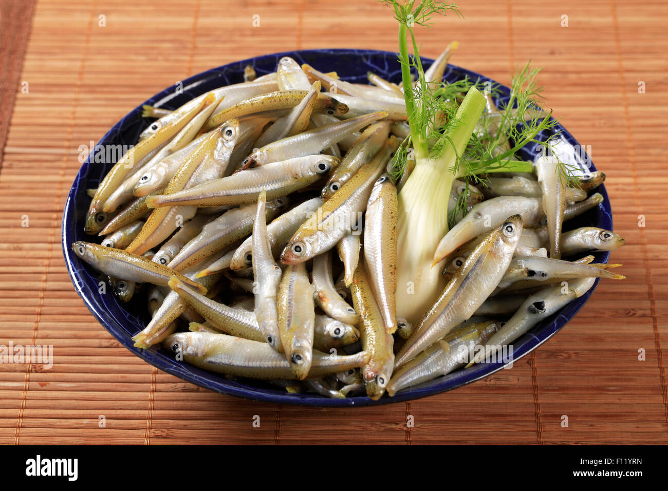 Closeup of a bowl of fresh anchovies Stock Photo