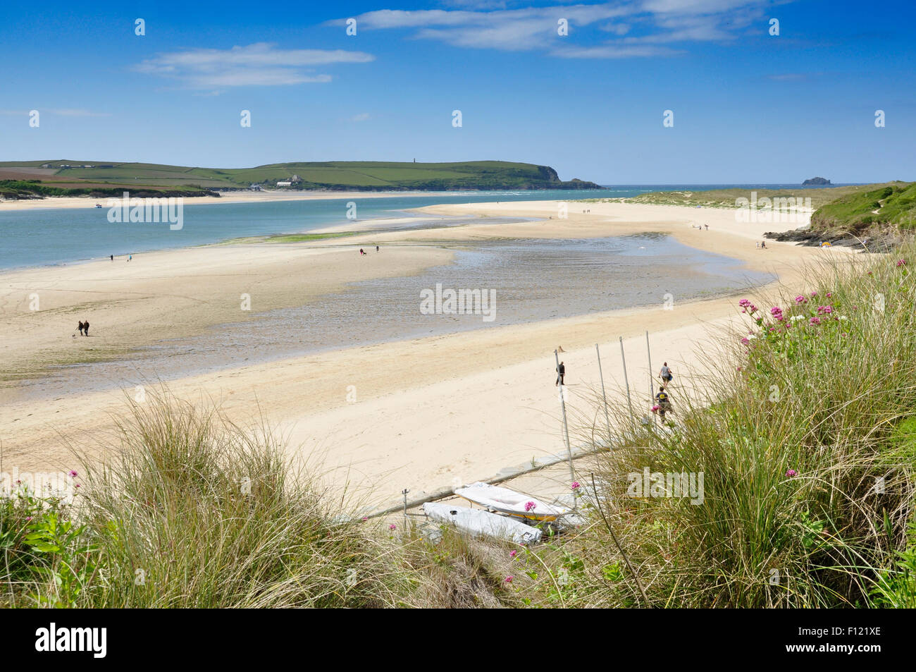 North Cornwall - low tide river Camel estuary - huge sandbar - ribbon of blue water - distant Stepper Point - sun - Stock Image