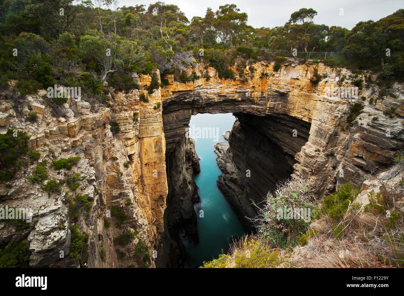 Impressing rocky bridge of Tasman Arch. - Stock Image