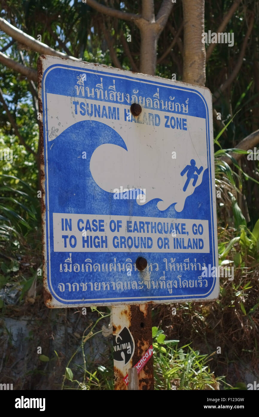A sign warning about tsunamis on Maya Beach, Koh Phi Phi, February 2015 after the devastation of 2005 - Stock Image