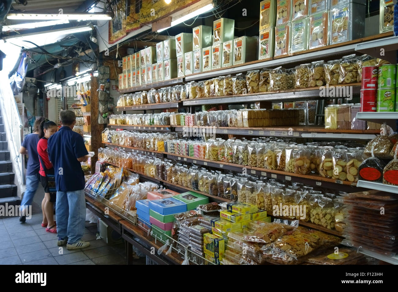 A variety of products in packets, boxes and jars in a stall in a Bangkok food market, Thailand - Stock Image