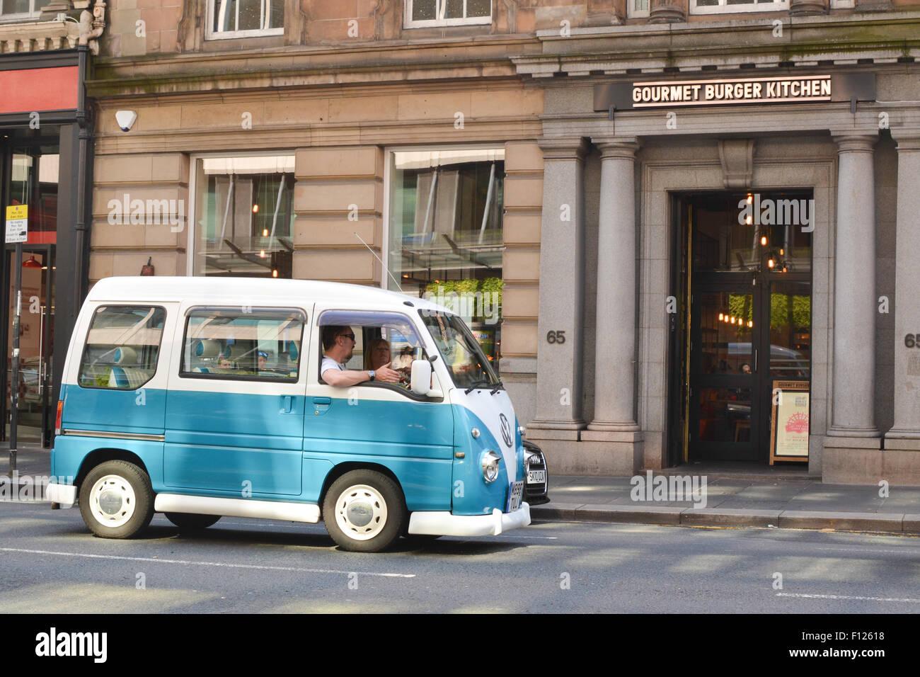 Subaru Sambar Auto VW Samba Camper replica driving in Glasgow city centre - Stock Image