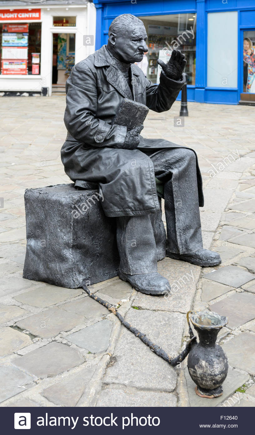 Living Statue street performer with a collection jar in a shopping centre in Chichester, West Sussex, England, UK. - Stock Image