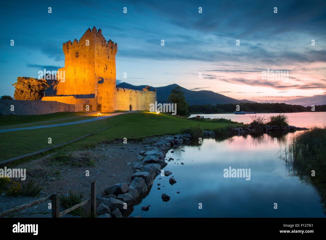 Twilight over Ross Castle (b. 15th Century) on Lough Leane near Killarney, County Kerry, Ireland - Stock Image
