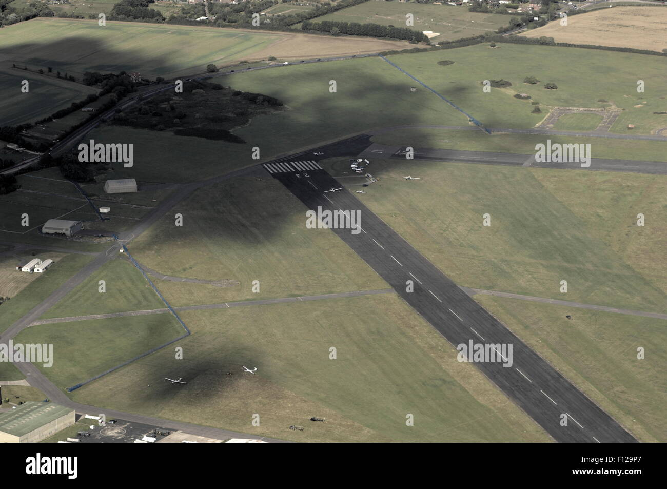 AJAXNETPHOTO. 2011. LEE ON SOLENT, ENGLAND. - AERIAL VIEW - LOOKING NORTH EAST SHOWING PART OF MAIN RUNWAY AND AIRFIELD - Stock Image
