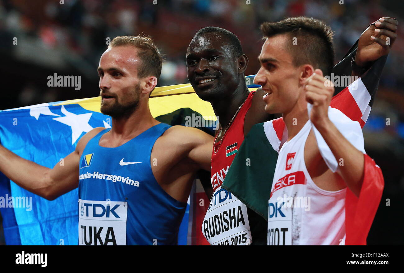 Beijing, China. 25th Aug, 2015. Bosnia and Herzegovina's Amel Tuka, Kenya's David Lekuta Rudisha, and Poland's - Stock Image