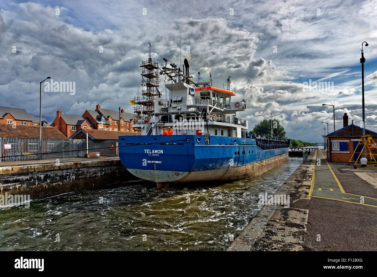 Coastal freighter 'Telamon' passing through Latchford Locks on the Manchester Ship Canal at Warrington, England. Stock Photo