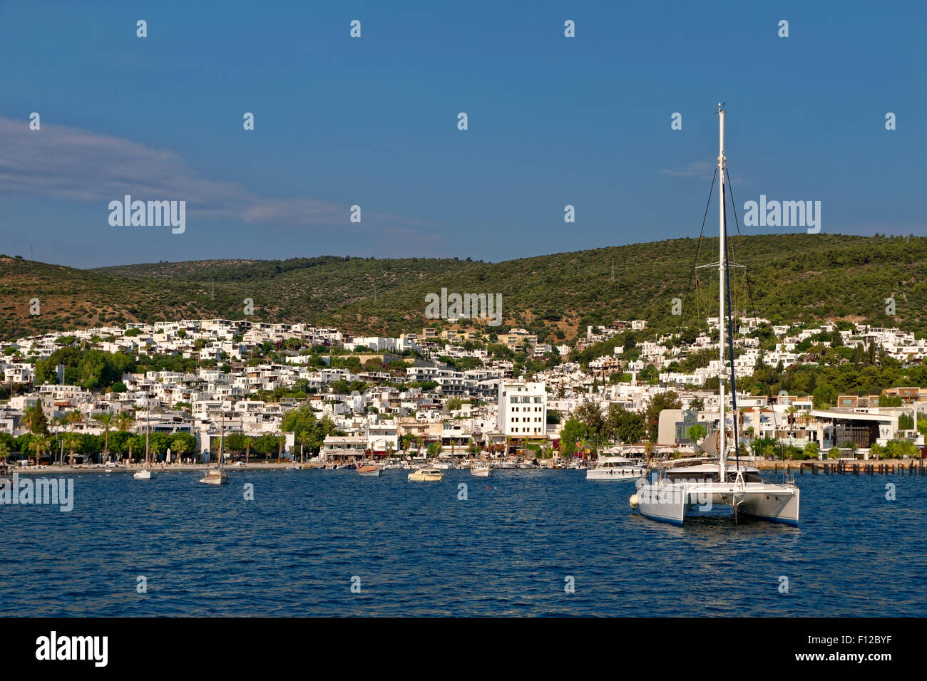 Catamaran and Yacht anchorages in the East Bay at Bodrum town, Muğla Province, Turkey - Stock Image