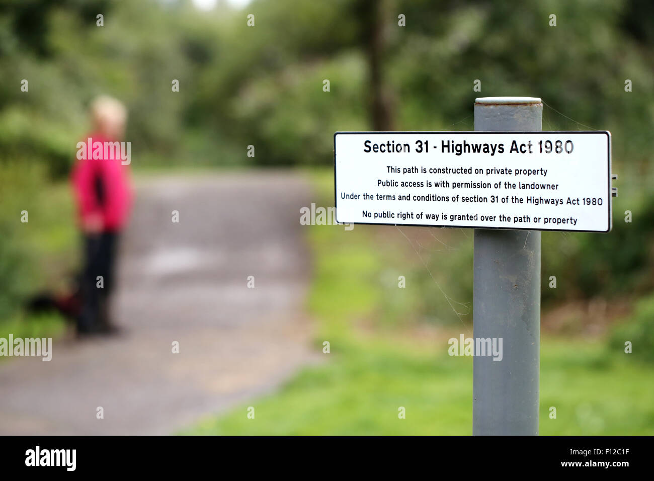 A Section 31 highways act sign on a public footpath stating that access to the area is with the permission of the - Stock Image