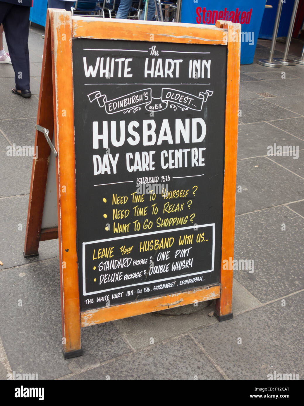 humorous sign outside the White Hart Inn in the historic Grassmarket area of Edinburgh, Scotland - Stock Image