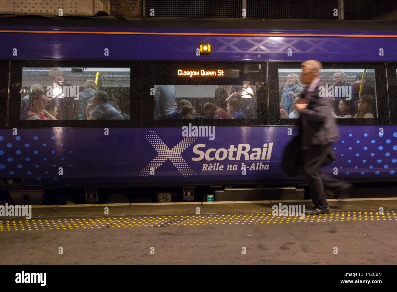 Gaelic branding on ScotRail train travelling between Edinburgh Waverley and Glasgow Queen Street stations - Stock Image