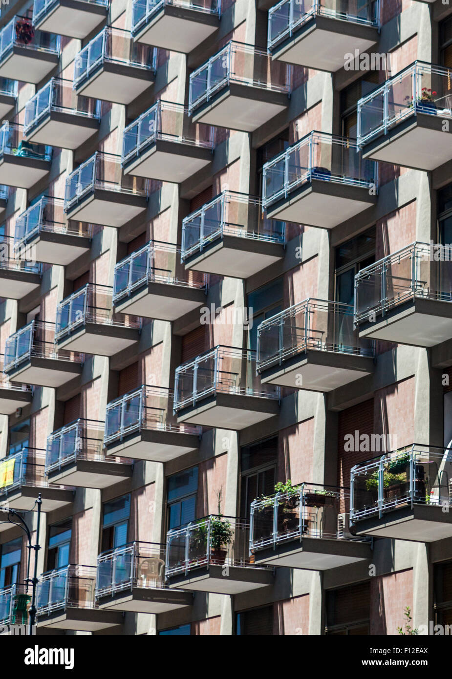 Balconies cling to the facade of a modern apartment house in Salerno, Italy - Stock Image