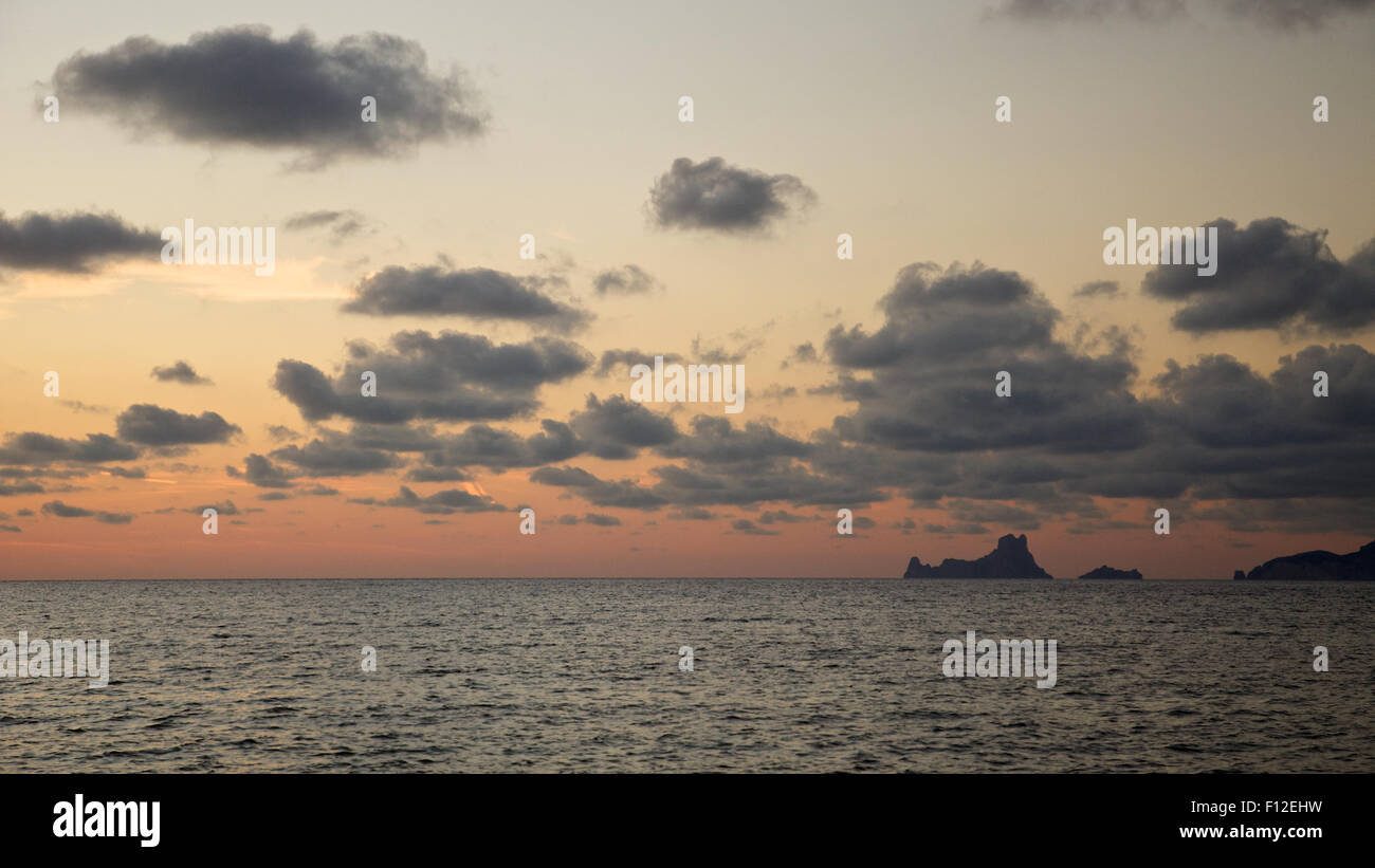 Panoramic view at sunset of Es Vedrá and Es Vedranell islets next to Ibiza coastline from Formentera (Pityusic - Stock Image