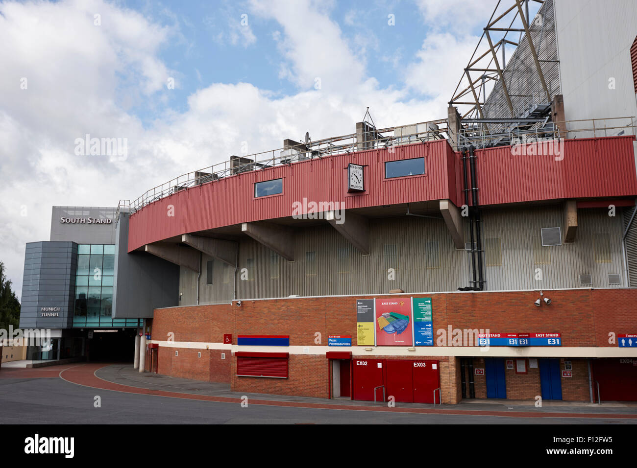 south stand munich clock and munich tunnel Manchester united old trafford stadium uk - Stock Image