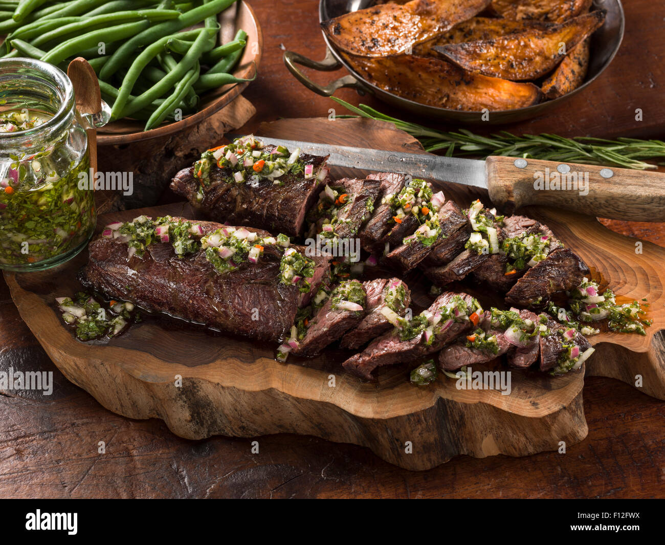 Onglet beef with chimichurri sauce - Stock Image