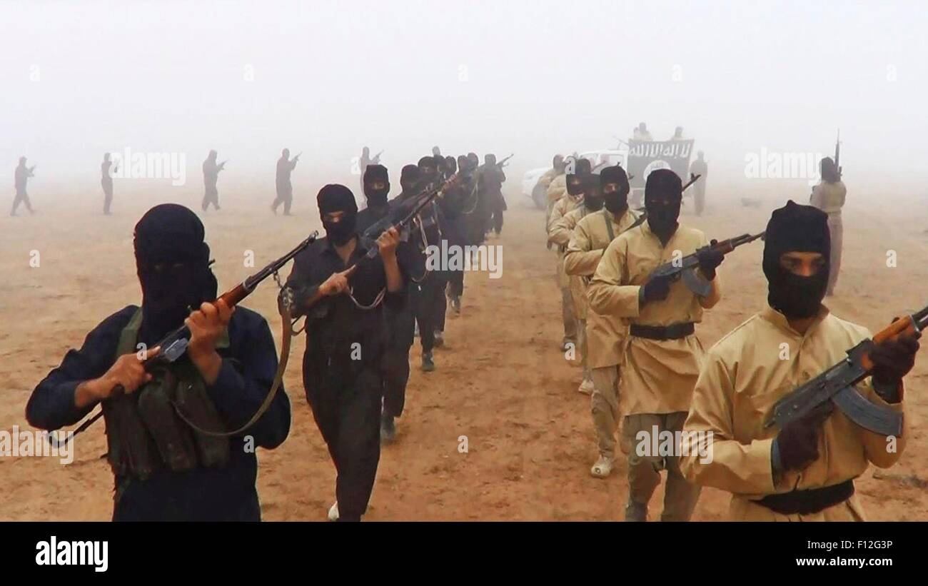 Islamic State of Iraq and the Levant fighters march shown in propaganda photos released by the militants. Stock Photo