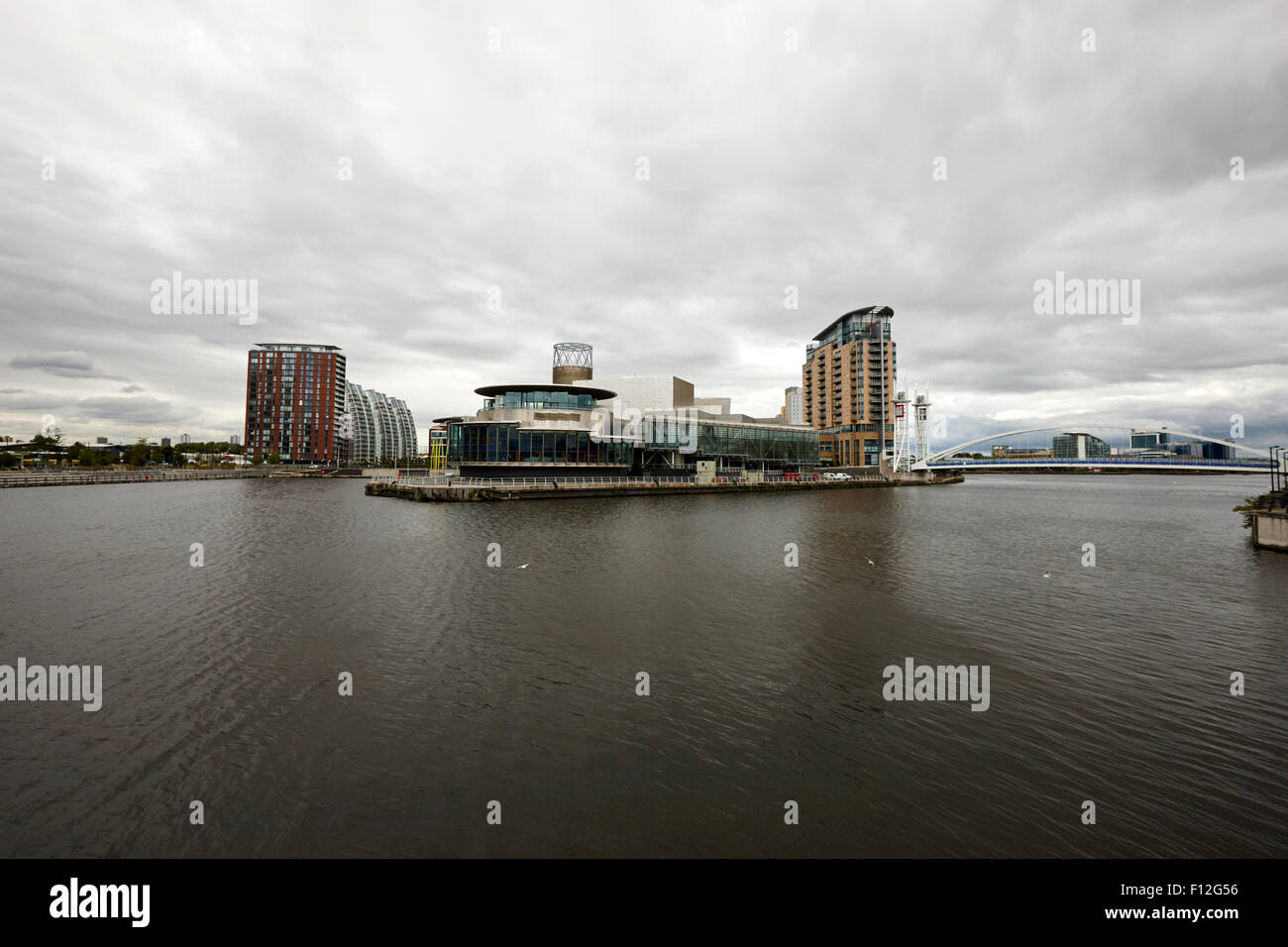 salford quays on a dull overcast day Manchester uk - Stock Image