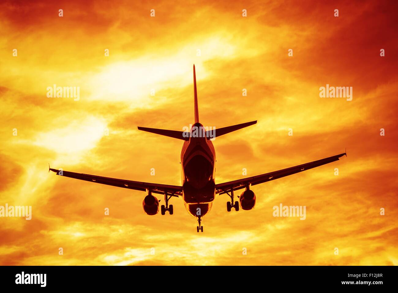 Business Flights Concept Photography. Commercial Airlines on the Sky During Sunset Take Off. - Stock Image
