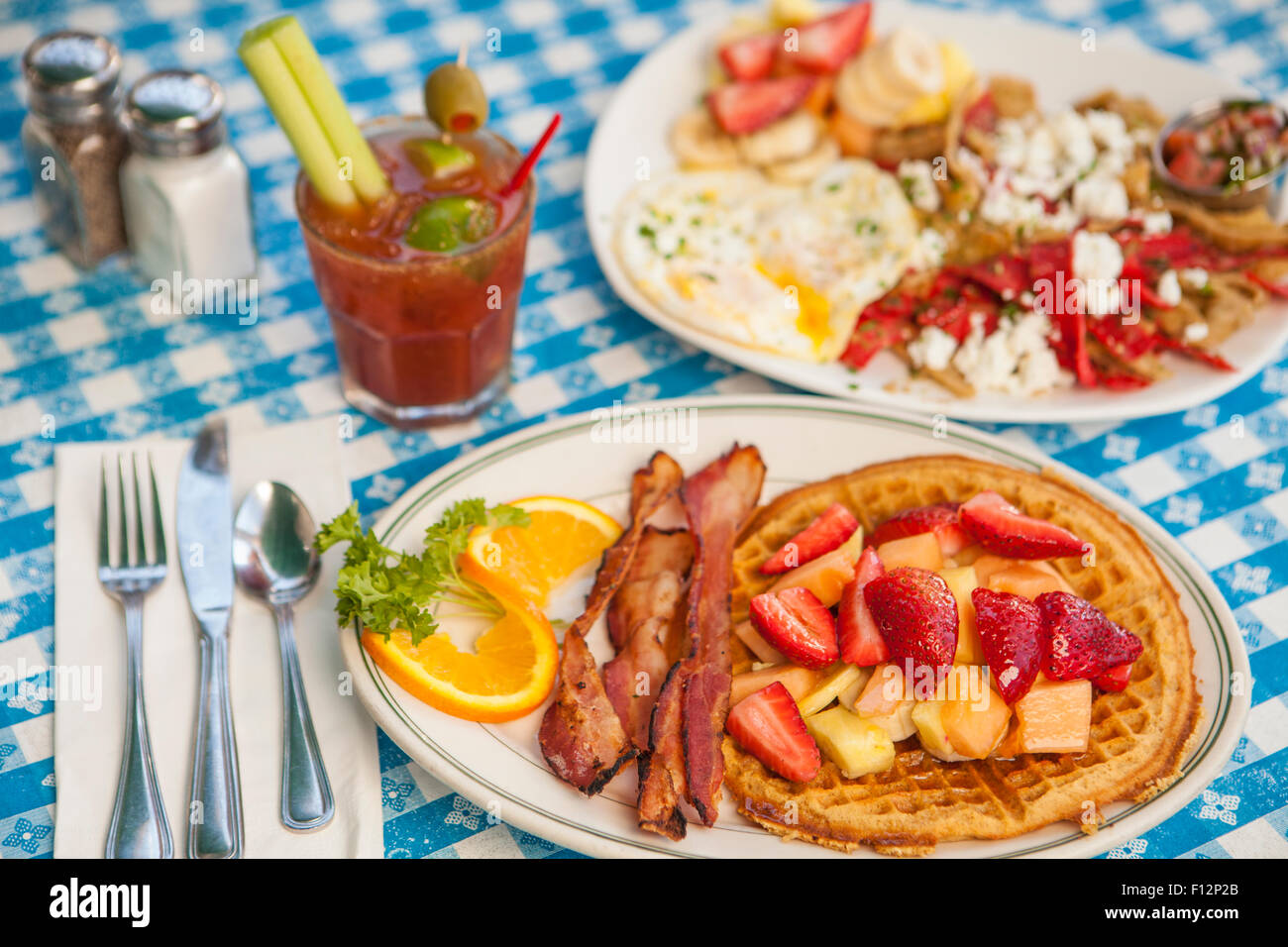 O.J.Waffle with bacon, Huevos Paradiso and a Bloody Mary, The Paradise Cafe, Santa Barbara, California - Stock Image