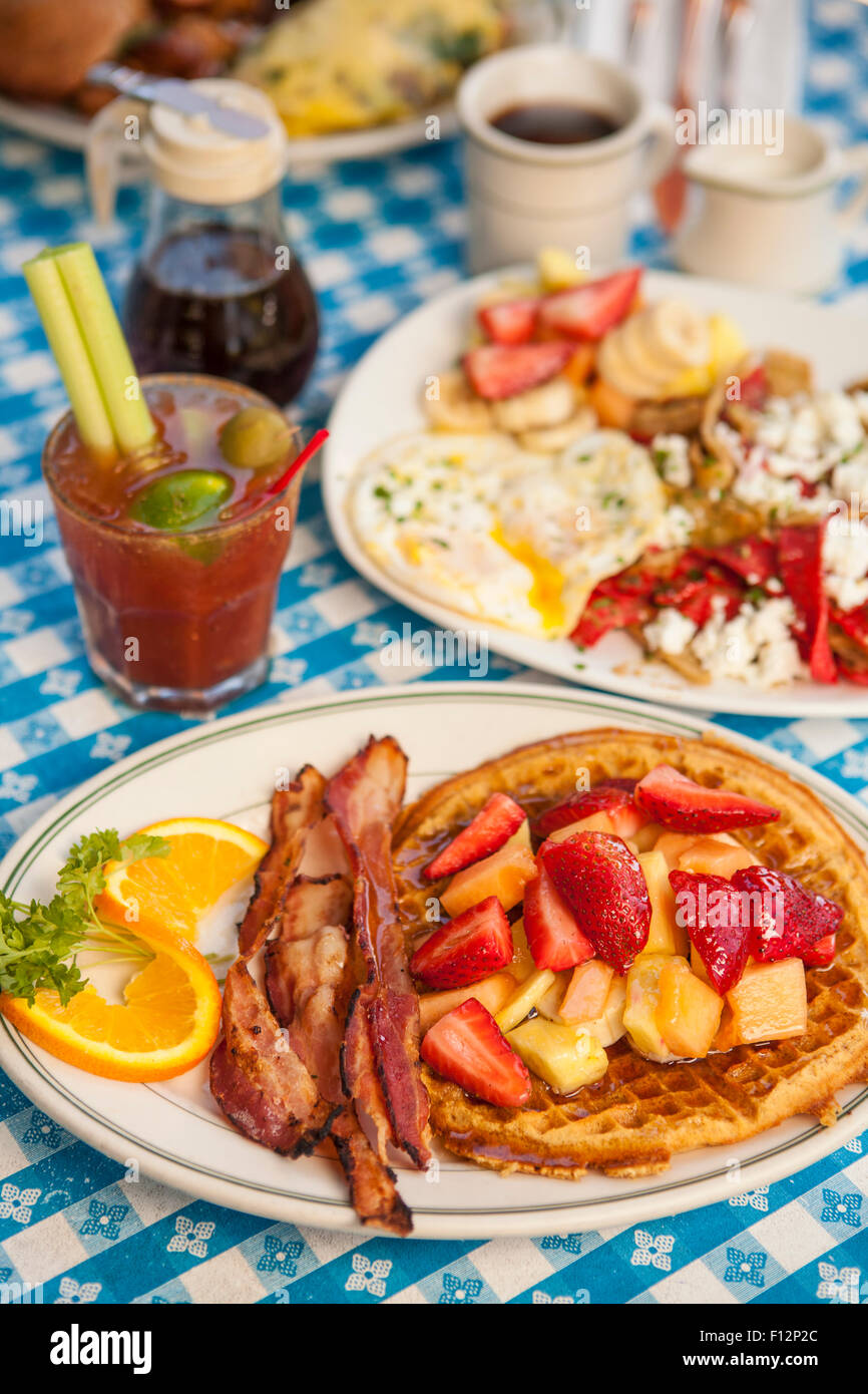 O.J.Waffle with bacon, Huevos Paradiso, a Paloma Omlette, coffee and a Bloody Mary, The Paradise Cafe, Santa Barbara, - Stock Image