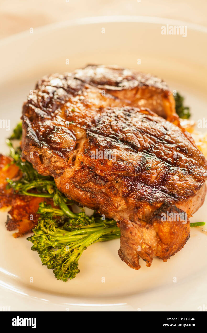 grilled rib-eye steak with roasted potatoes, garlic confit and avocado chimichurri, Ember Restaurant, Arroyo Grande, Stock Photo
