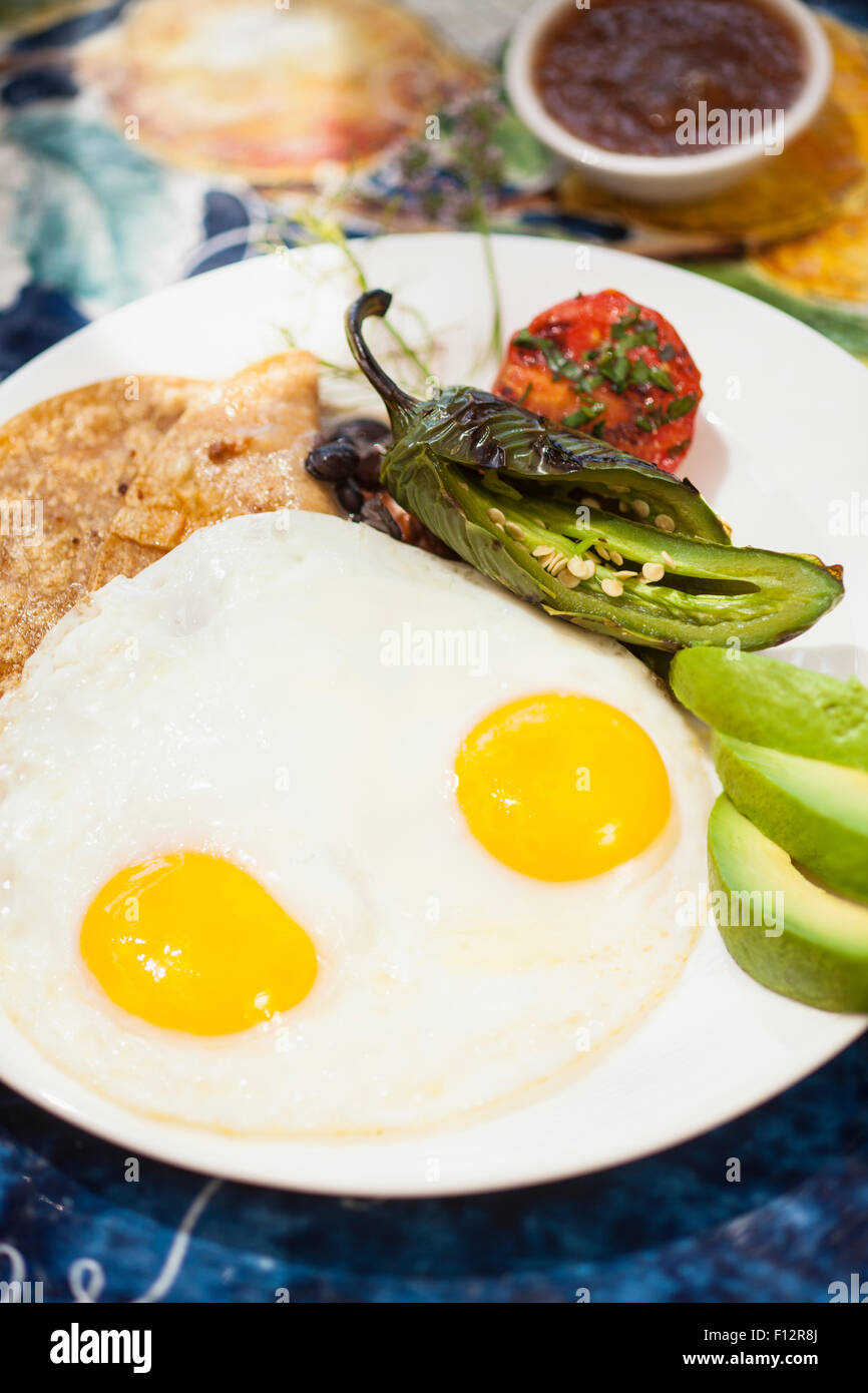 huevos rancheros with tortilla, roasted chile and avocado, Bella Vista Restaurant, Biltmore Hotel, Santa Barbara, - Stock Image