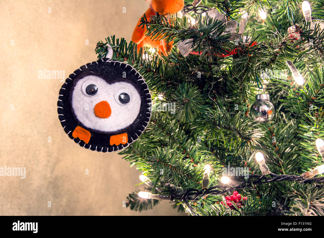 detail of Christmas tree decorated with handmade animal decoration - Stock Image