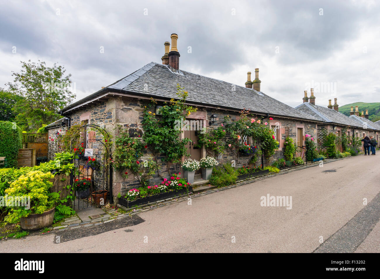 Traditional old stone built cottages in village of Luss at Loch Lomond, Argyll and Bute, Scotland - Stock Image
