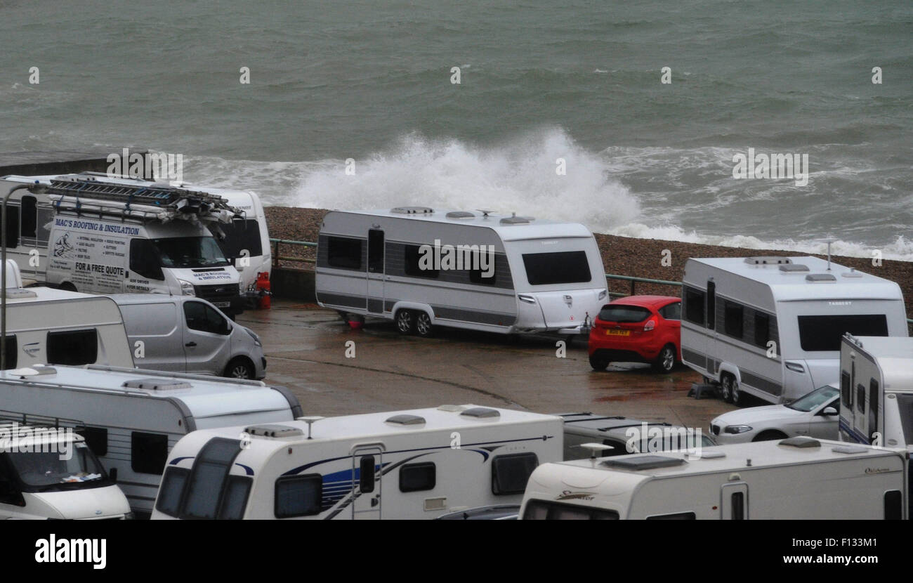 Brighton, UK. 26th August, 2015. UK weather. Waves crash on to the beach at Black Rock in Brighton where a group - Stock Image