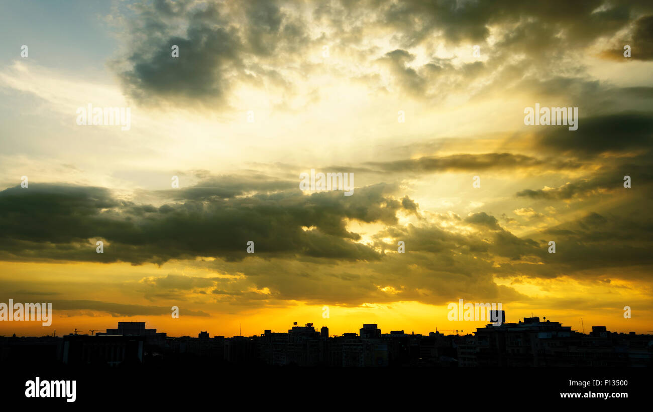 Bucharest skyline at sunset under beautiful clouds. - Stock Image