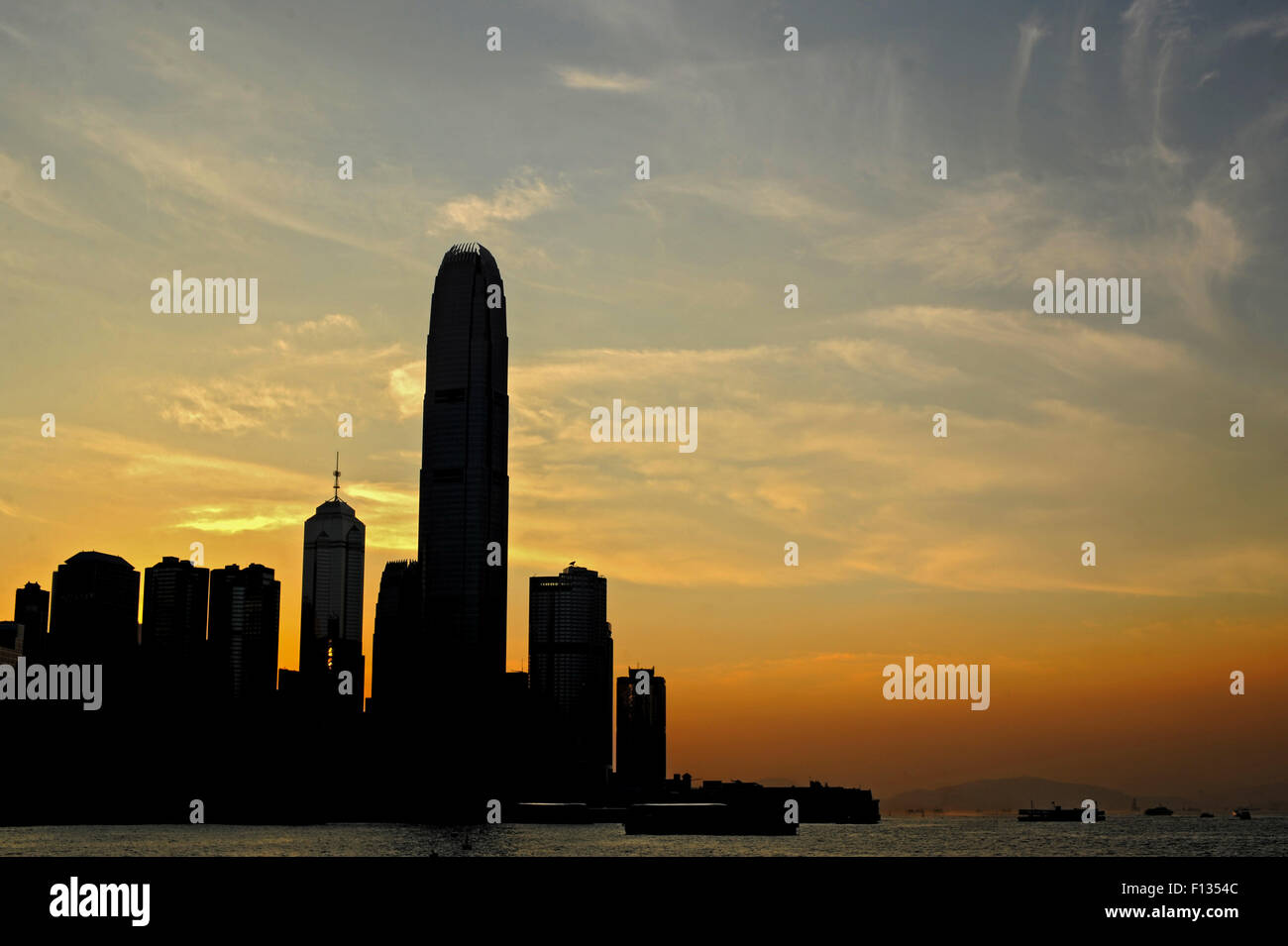 The suns sets over Hong Kong in 2011. Ian Alexander - Stock Image