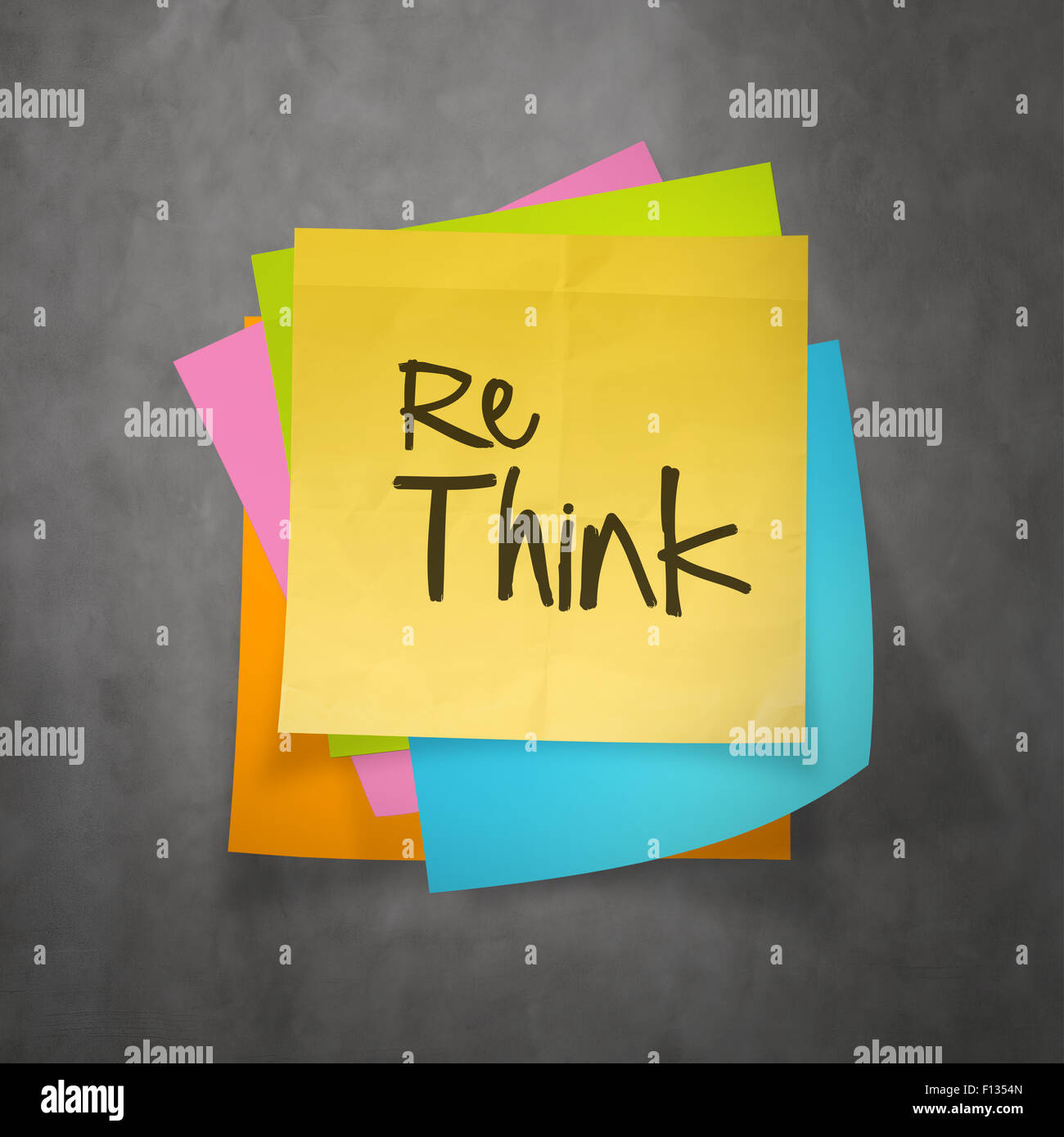Hand drawn  RETHINK word paper sticky note on texture background as concept - Stock Image