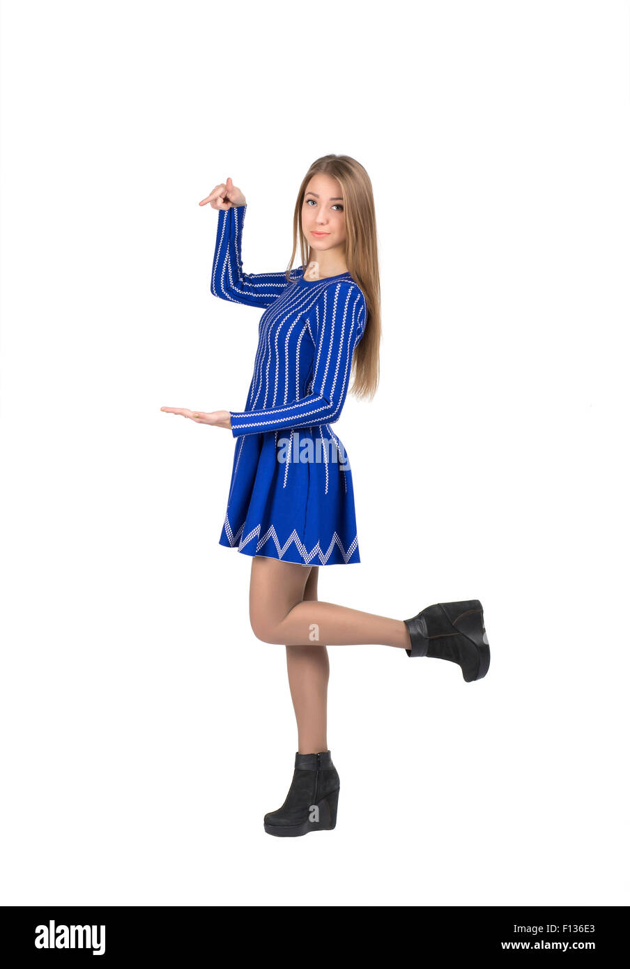 Young lady pointing on something - Stock Image
