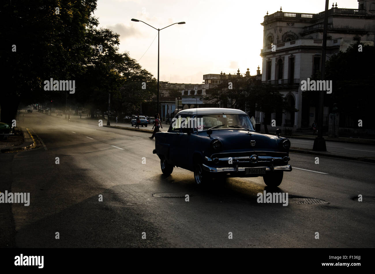 A vintage car speeding up in the evening of central havana, Cuba - Stock Image